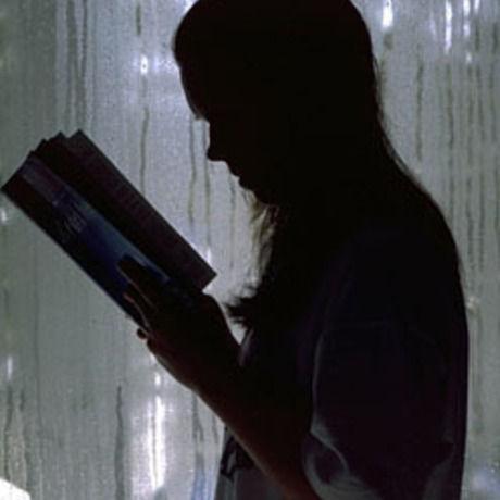 Girl reading silhouette