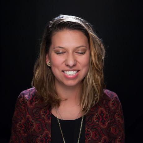 Danielle dark headshot smiling reduced