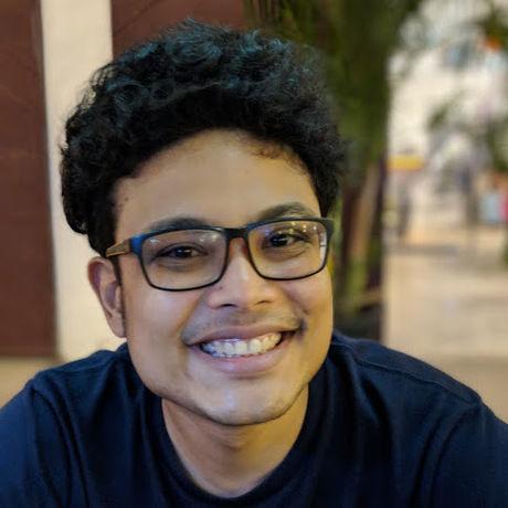 Hakim smiling