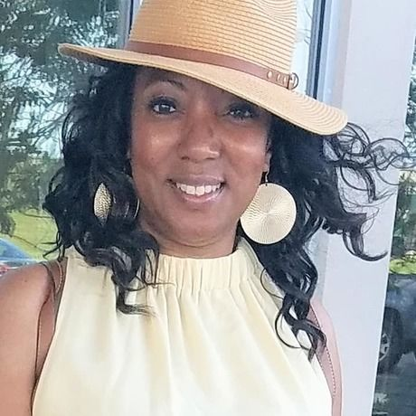 Sharon in yellow dress and hat